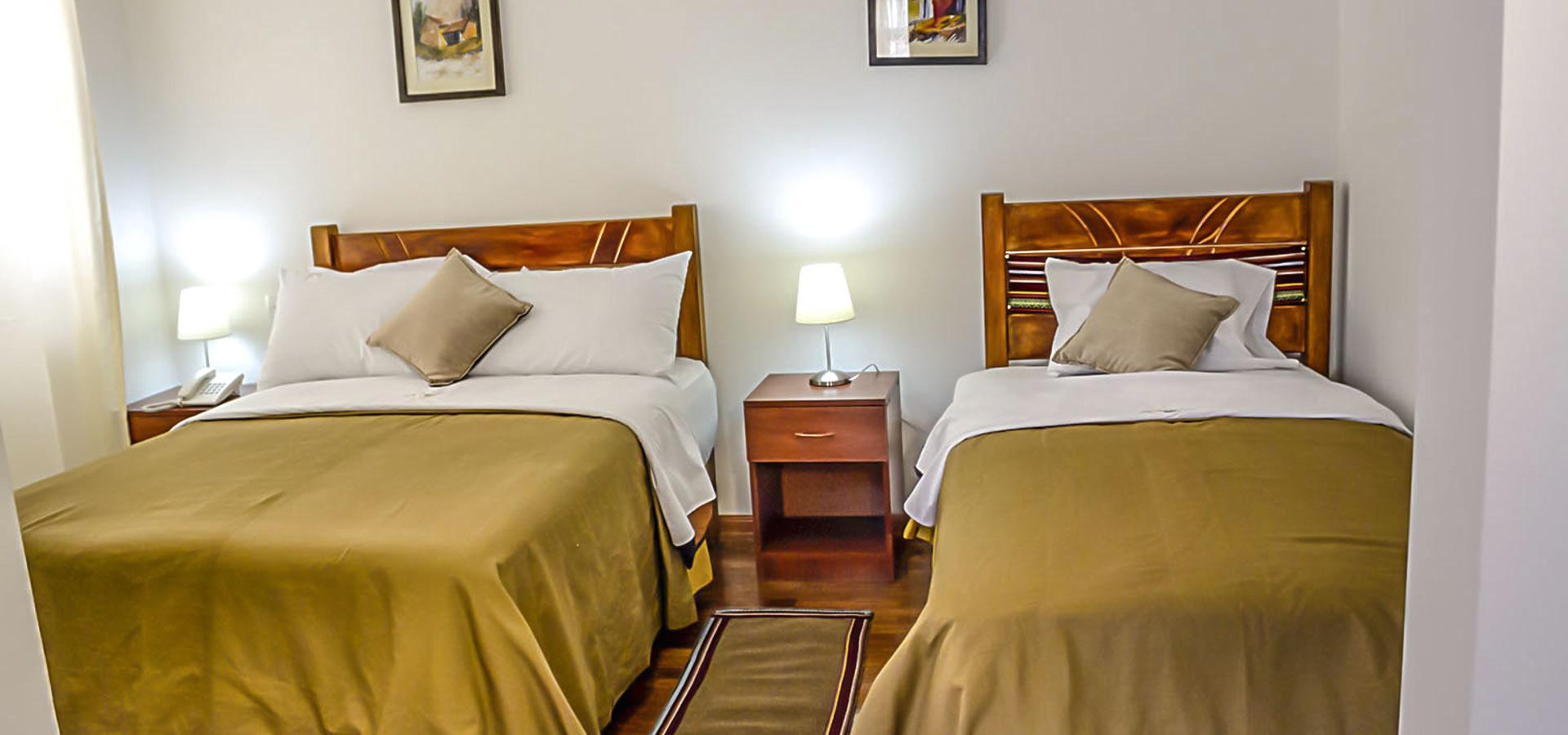 Villa valencia hotel hoteles en huaraz bungalows en for Habitaciones familiares valencia